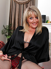 Alluring milf Bobbie Jones in her silk robe and fishnet body stocking