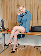 Horny blonde secretary pulls up her skirt revealing her black panties in the office