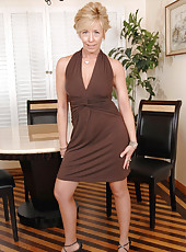 Glamorous Anilos cougar Chanel lifts up her beautiful sexy dress revealing her black thongs