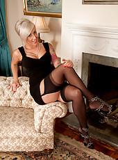 Pretty blonde in her elegant evening wear gets naughty