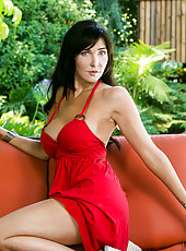 Stunning cougar looks sinfully sexy in her red dress