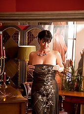 Sensual older milf poses in lingerie in the mirror