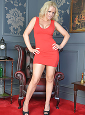 Steaming hot cougar shows her big round tits in a red dress