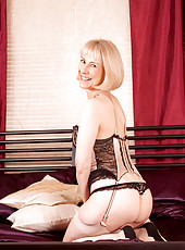Short haired blonde Anilos Hazel in sexy lingerie flirts and poses her hot mature body in bed
