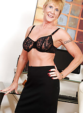 Honey Ray is a sexy mature secretary that will rock your cock