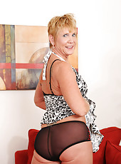 Short haired Anilos granny shows off in her sheer bra and panties