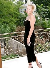 Seductive blonde cougar jacy andrews lifts her black velvet gown exposing a beautiful ass