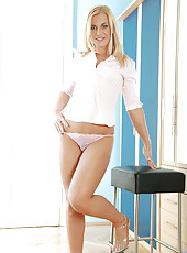 Anilos cougar Janet takes off her pink top exposing her sheer bra and pantie set