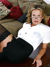 Seductive secretary poses and teases us with her milf beauty