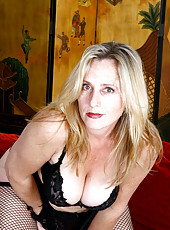 Busty cougar Jordan teasingly shows off her tempting cleavage in her sheer fishnet lingerie