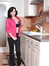 Naughty Karen Kougar strips off her office attire and exposes her underwear set in the kitchen