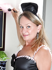 Flirty milf maid doing her chores with her famous sex uniform