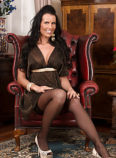 Breath-taking milf Katie Smith wears ultra sexy black lingerie and stockings