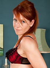 Amateur redhead in sweet evening wear reveals sexy bra and thong