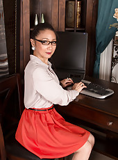 Kim is a naughty Asian secretary that loves pleasuring her pussy