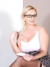 Seductive milf Kimi wearing glasses teases us in her short skirt