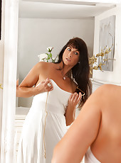 Hot mommy lifts up her white dress to show off her sexy legs
