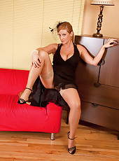 Busty Anilos Leona Lee flaunts her big cleavage and spreads her legs really nice