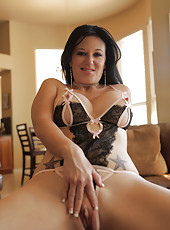 Naughty housewife Licious Gia spreads open her smooth pierced twat