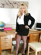 Naughty secretary gives you a peek up her skirt