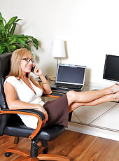 Looking at these free pics of this hot cougar secretary reminds me of my strict college professor who I always wanted to fuck
