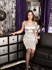 Classy milf with a round juicy ass wears a skin tight satin dress
