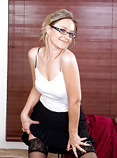 Sexy Anilos Nicole Logan takes off her clothes after a long hectic day in the office