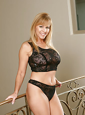 Drop dead gorgeous Anilos Nicole Moore flaunts her body in lacy sheer lingerie
