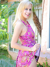 Anilos Payton Leigh pulls up her elegant dress to reveal her tiny thong