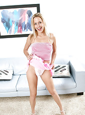 Elegant anilos woman pulls down her ruffly pink skirt revealing her lacy thong