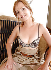 Hot milf Sadie peels off her evening wear and shows off her bra and thong set