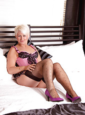 Honey blonde milf Sally Taylor teases us with her sexy hot lingerie in her bedroom