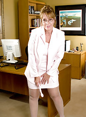 Tempting hot secretary teases us with her classy beauty in the office