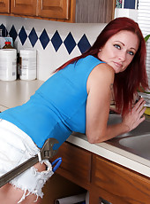 Horny housewife handles the chores like a sexy pro