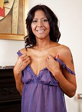 Sweet milf in lavender lingerie teases on her bed