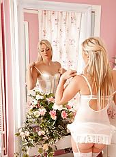 Slender blonde milf looks angelic in her white lingerie