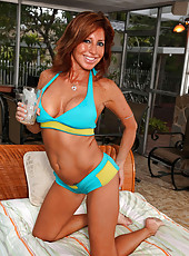 Seductive Anilos Tara Holiday flaunts her luscious cougar frame in a sexy bikini