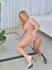 Horny older mom with huge boobs finger fucks her wet snatch