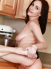 Naughty wife stirs up some sweet cream between her legs