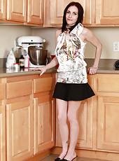 Take a peek up the skirt of this smoking hot milf