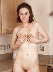 Gorgeous Tina Kay plays with her rock hard nipples and big perky boobs