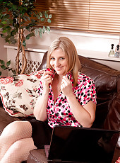 Mature milf Tonya shows off her luscious legs in stockings and heels