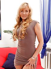 Mature milf Zlata strips off her skirt exposing her sexy bikini