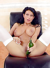 Big titted Bianca masturbates with a huge toy and cucumber
