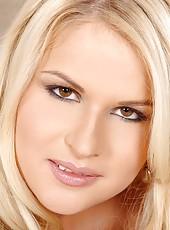 Blonde Charlotte Flame masturbates