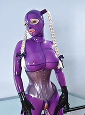 Latex Lucy fucks herself with a toy