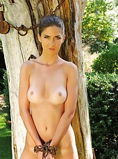 Charlotta  chained to a tree nude