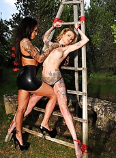 Mistress Whips Tattooed Babe