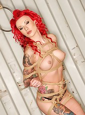 Tattooed Redhead Tied Up In Knots