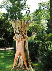 Blonde Chained Up To A Tree Pees